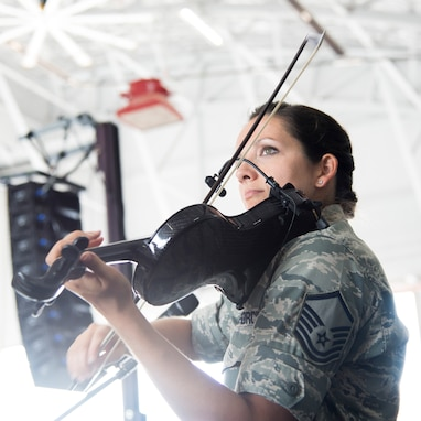 Master Sgt. Emily Wellington, both a Singing Sergeant and violinist with Celtic Aire, performs inside Hangar 3 on Joint Base Andrews, Md., during the 2015 Air Show, Sept. 19. (U.S Air Force photo by Airman 1st Class Philip Bryant/Released)