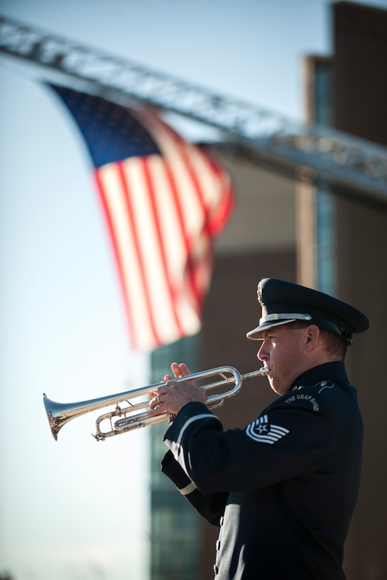 Technical Sgt. Matthew Misener plays Taps during a Patriot's Day Reveille Ceremony at Heritage Park, Joint Base Andrews, Md., Sept. 11, 2015. The ceremony paid tribute to the first responders and victims of the terrorist attacks on Sept. 11, 2001. (U.S. Air Force photo by Airman 1st Class Philip Bryant/released)