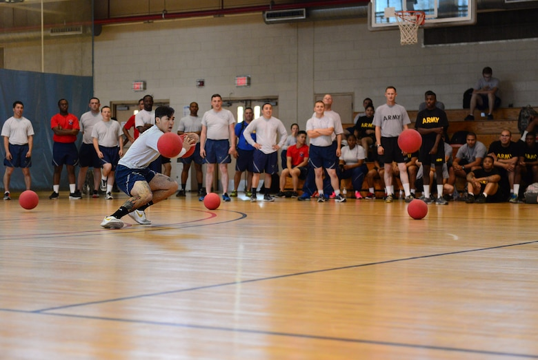 Battle rages as members of Team Osan furiously compete for the title of dodgeball champion during the second annual Osan Cup held at Osan Air Base, Republic of Korea, Sept. 30, 2015. The Osan Cup is a two-day contest with a variety of events designed to play to different strengths and promote healthy competition. (U.S. Air Force photo/Staff Sgt. Amber Grimm)