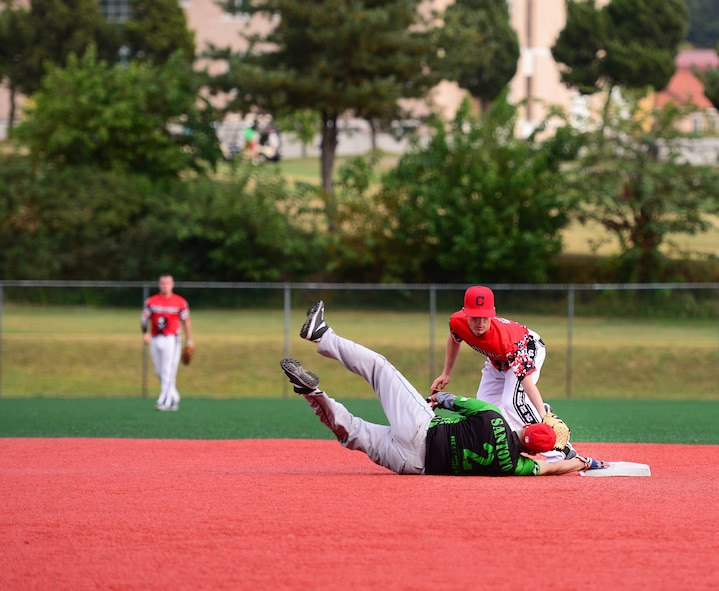 Airman 1st Class Ivan Santoyo, 51st Security Forces Squadron, dives back to second base during a softball game against Soldiers from the 35th Air Defense Artillery Brigade Squadron at Osan Air Base, Republic of Korea, Sept. 29, 2015. Softball was just one of the events Airmen and Soldiers competed in during the second annual Osan Cup.