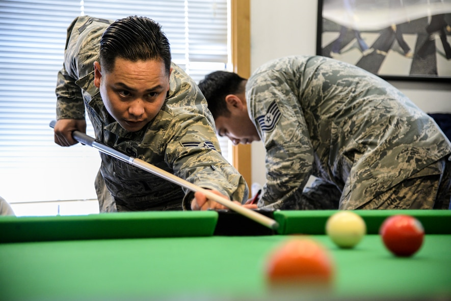 Staff Sgt. Ryan Reyes, 51st Fighter Wing weapons safety manager, takes a shot during the 9-Ball tournament in the Osan Cup at Osan Air Base, Republic of Korea, Sept. 30, 2015. The Osan cup is a sport-oriented, two-day event that puts squadrons and service members against each other in a battle royal to show who has the most skill, strength and knowledge. (U.S. Air Force photo/Tech. Sgt. Travis Edwards)