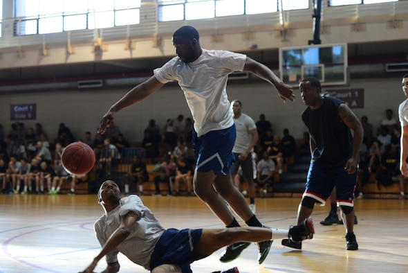 Osan's Airmen leave it all on the court as they battle it out during the 3-on-3 basketball challenge at Osan Air Base, Republic of Korea, Sept. 29, 2015. The challenge was just one of the events that took place during the second annual Osan Cup.