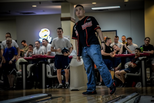 Tech. Sgt. Paul Miller, 51st Communication Squadron communications focal point technician, watches as his bowling ball travels down the lane, bound for the destruction of the bowling pins during a bowling tournament at the MiG Alleys Bowling Center during the Osan Cup at Osan Air Base, Republic of Korea, Sept. 30, 2015. The Osan cup is a sport-oriented, two-day event that puts squadrons and service members against each other in a battle royal to show who has the most skill, strength and knowledge. (U.S. Air Force photo/Tech. Sgt. Travis Edwards)