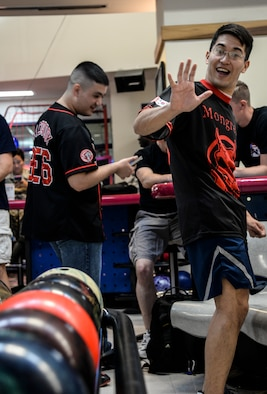 1st Lt. Andrew Davenport, 51st Civil Engineer Squadron officer in charge of requirements and optimization, excitedly smiles and waves at the camera during a bowling tournament at the MiG Alleys Bowling Center during the Osan Cup at Osan Air Base, Republic of Korea, Sept. 30, 2015. The Osan cup is a sport-oriented, two-day event that puts squadrons and service members against each other in a battle royal to show who has the most skill, strength and knowledge. (U.S. Air Force photo/Tech. Sgt. Travis Edwards)