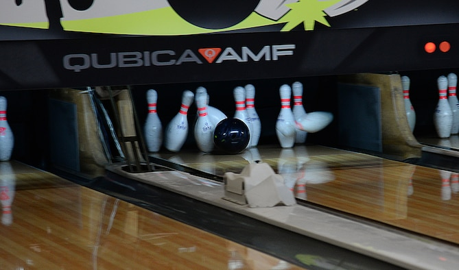 A bowling ball slams into a set of pins during a game of bowling at the MiG Alleys Bowling Center during the bowling tournament in the Osan Cup at Osan Air Base, Republic of Korea, Sept. 30, 2015. The Osan cup is a sport-oriented, two-day event that puts squadrons and service members against each other in a battle royal to show who has the most skill, strength and knowledge. (U.S. Air Force photo/Tech. Sgt. Travis Edwards)