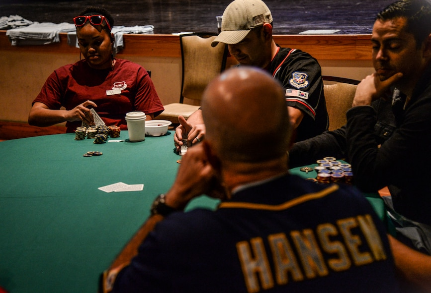 Col. Andrew Hansen, 51st Fighter Wing commander waits for his turn during the Texas Hold 'em tournament in the Osan Cup at Osan Air Base, Republic of Korea, Sept. 29, 2015. Out of nearly 130 Airmen and Soldiers, Hansen made it to the final four tables before getting knocked out of the tournament. The Osan cup is a sport-oriented, two-day event that puts squadrons and service members against each other in a battle royal to show who has the most skill, strength and knowledge. (U.S. Air Force photo/Tech. Sgt. Travis Edwards)
