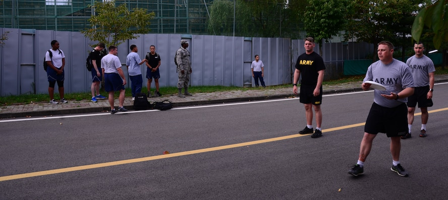 Members of Team Osan practice and warm up before the start of the disk golf competition Sept. 30, 2015, at Osan Air Base, Republic of Korea. The competition was held Sept. 29-30, and was open to all squadrons, groups, divisions, tenant units and other organizations assigned to Osan. (U.S. Air Force photo by Staff Sgt. Benjamin Sutton)