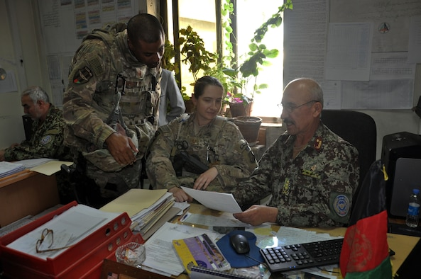 Master Sgts. Neal Harris and Andrea Brown, Train, Advise, Assist Command – Air (TAAC-Air) force management advisors, meet with their Afghan Air Force counterpart Sept. 28, 2015, to discuss the AAF's unit manning document, or Tashkil, to help shape the future of the Afghan National Defense Security Forces, for years to come. The Tashkil is the Afghan manpower requirements document which identifies what people and resources are needed to sustain the AAF and complete their mission. (U.S. Air Force photo by Capt. Eydie Sakura/released)
