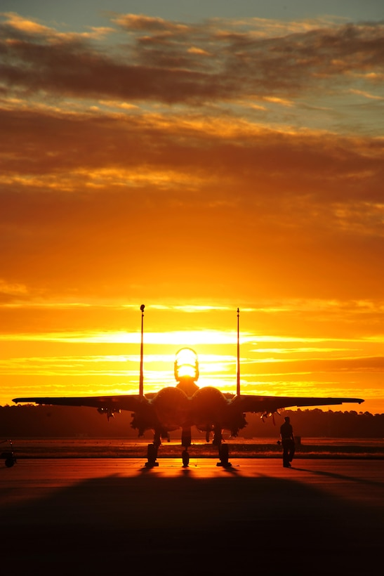 An F-15 Eagle from Seymour Johnson Air Force Base, N.C., sits on the flightline before an early morning training sortie Sept. 17, 2015, at Tyndall AFB, Fla. The unit traveled to Tyndall AFB to participate in the Combat Archer exercise, a weapons system evaluation program designed to test the effectiveness of our Airmen and air-to-air weapon system capability of combat aircraft. (U.S. Air Force photo/Senior Master Sgt. Beth Holliker)