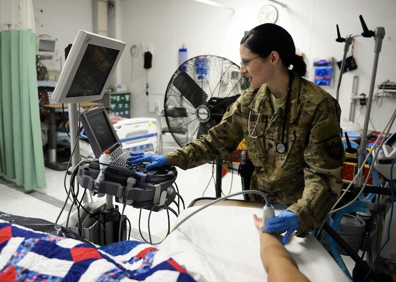 Maj. Anjeli Nayar, a 455th Expeditionary Medical Operations Squadron intensive care unit general internist, simulates patient care on a hospital staff member Sept. 19, 2015, at Bagram Airfield, Afghanistan. Nayar is responsible for coordinating care for military members, defense civilians, civilian contractors, as well as some Afghan nationals, in the ICU at the Craig Joint Theater Hospital. (U.S. Air Force photo/Senior Airman Cierra Presentado)