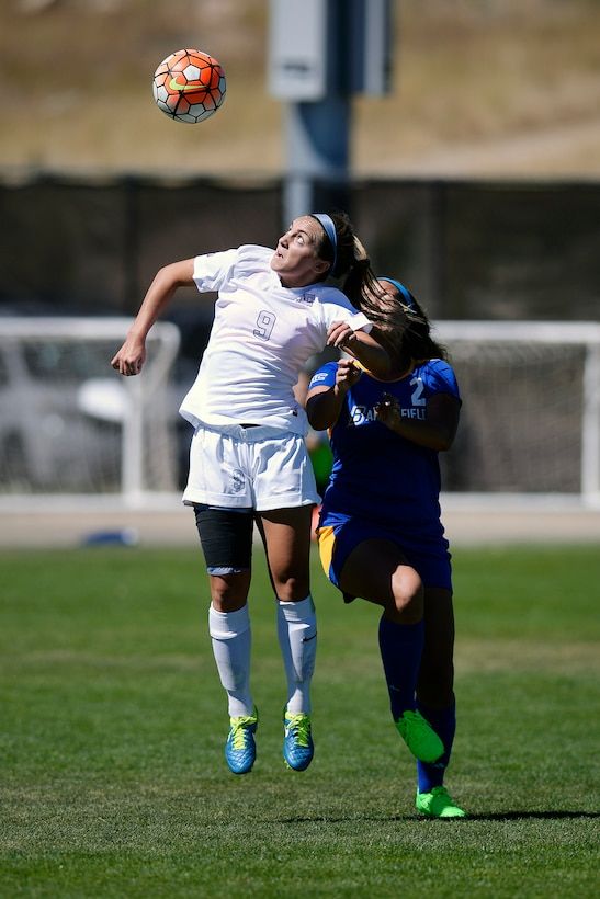 Brooke Rittmann, a U.S. Air Force Academy sophomore, goes up for the header against  a player from California State University, Bakersfield, at the Academy's Cadet Soccer Stadium in Colorado Springs, Colo., Sept. 20, 2015. The Falcons dropped the nonconference match 2-1. (Air Force photo/Mike Kaplan)
