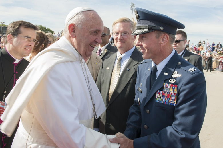 Col. Brad Hoagland, the Joint Base Andrews commander, greets Pope Francis on the base flightline Sept. 24, 2015. The pope visited New York and Philadelphia during his U.S. trip before returning to Rome Sept. 27. (U.S. Air Force photo/Tech. Sgt. Robert Cloys)