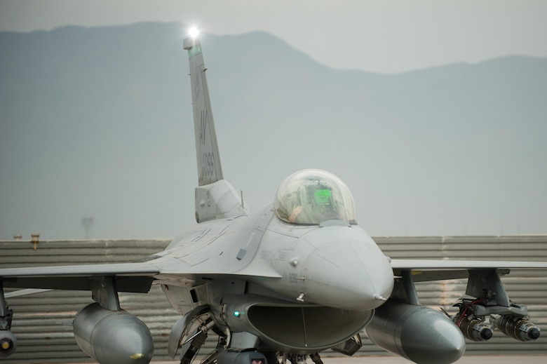 An F-16 Fighting Falcon pilot assigned to the 555th Expeditionary Fighter Squadron goes through a preflight inspection before a combat sortie at Bagram Airfield, Afghanistan, Sept. 22, 2015. The F-16 is a multi-role fighter aircraft that is highly maneuverable and has proven itself in air-to-air and air-to-ground combat. (U.S. Air Force photo/Tech. Sgt. Joseph Swafford)