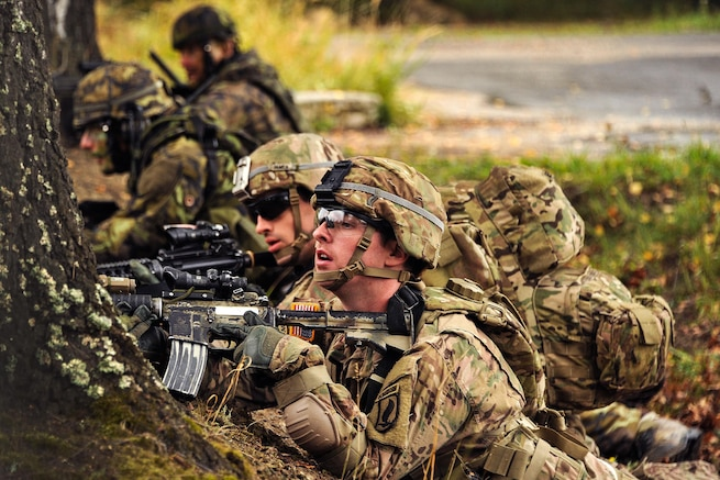 U.S. and Czech army paratroopers conduct an attack on urban terrain as part of Exercise Sky Soldier II at the Training Area in Bechyne, Czech Republic, Sept. 23, 2015. U.S. Army photo by Markus Rauchenberger