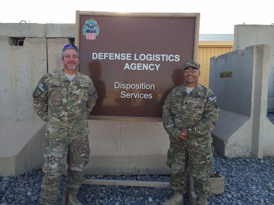 Kent Martz on the right posing with a teammate, a safety specialist at Defense Logistics Agency Distribution Red River, Texas, has spent the last six months in Afghanistan supporting the MRAP Demilitarization mission.