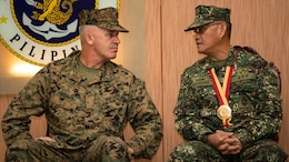 U.S. Marine Corps Brig. Gen. Paul J. Kennedy, 3rd Marine Expeditionary Brigade, commanding general, left, speaks with Philippine Marine Corps Maj. Gen. Alexander F. Balutan,  Armed Force Philippines, Naval Inspector General, during the opening ceremony for Amphibious Landing Exercise 2015 (PHIBLEX 15) at the Philippine Marine Corps Base in Fort Bonifacio, Taguig City, Philippines, Oct. 1, 2015. PHIBLEX 15 is an annual, bilateral training exercise conducted by U.S. Marine and Navy Forces with the Armed Forces of the Philippines in order to strengthen our interoperability and working relationships across the range of military operations from disaster relief, to complex expeditionary operations.