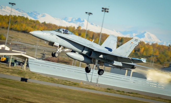 A Navy F-18 Hornet leaves the flight line Sept. 23, 2015 for dissimilar air combat training at Joint Base Elmendorf-Richardson, Alaska. Dissimilar air combat training involves different types of airframes training with and against each other. The goal is to expand pilots' proficiency in as many circumstances as possible. (U.S. Air Force photo/Airman 1st Class Kyle Johnson)