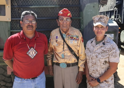 Navajo Code Talker Samuel T. Holiday poses with his son, Ricky Gray, and 1st Sgt. Christina Hunts Horse-May, first sergeant for Company C, 9th Communication Battalion, I Marine Expeditionary Force Headquarters Group, during a visit to a static display held by 9th Comm. Bn. aboard Marine Corps Base Camp Pendleton, Calif., Sept. 28, 2015. The visit allowed for the Marines to showcase their communications capabilities and build a bond between them and the Code Talkers. (U.S. Marine Corps photo by Pfc. Devan K. Gowans)