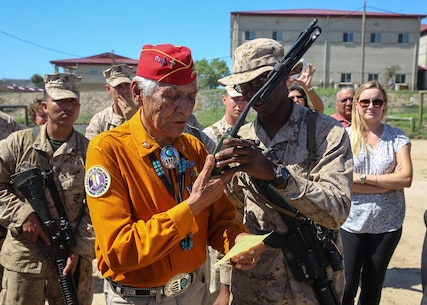 Navajo Code Talker Roy Hawthorne relays a message in Navajo to fellow Code Talker Samuel T. Holiday, during a visit to a static display held by 9th. Communication Battalion, I Marine Expeditionary Force Headquarters Group, aboard Marine Corps Base Camp Pendleton, Sept. 28, 2015. The visit allowed for the Marines to showcase their communication capabilities and build a bond between them and the Code Talkers. (U.S. Marine Corps photo by Pfc. Devan K. Gowans)