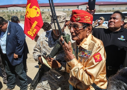 Navajo Code Talker Samuel T. Holiday relays a message in Navajo to fellow Code Talker Roy Hawthorne, during a visit to a static display held by 9th. Communication Battalion, I Marine Expeditionary Force Headquarters Group, aboard Marine Corps Base Camp Pendleton, Sept. 28, 2015. The visit allowed for the Marines to showcase their communication capabilities and build a bond between them and the Code Talkers. (U.S. Marine Corps photo by Pfc. Devan K. Gowans)