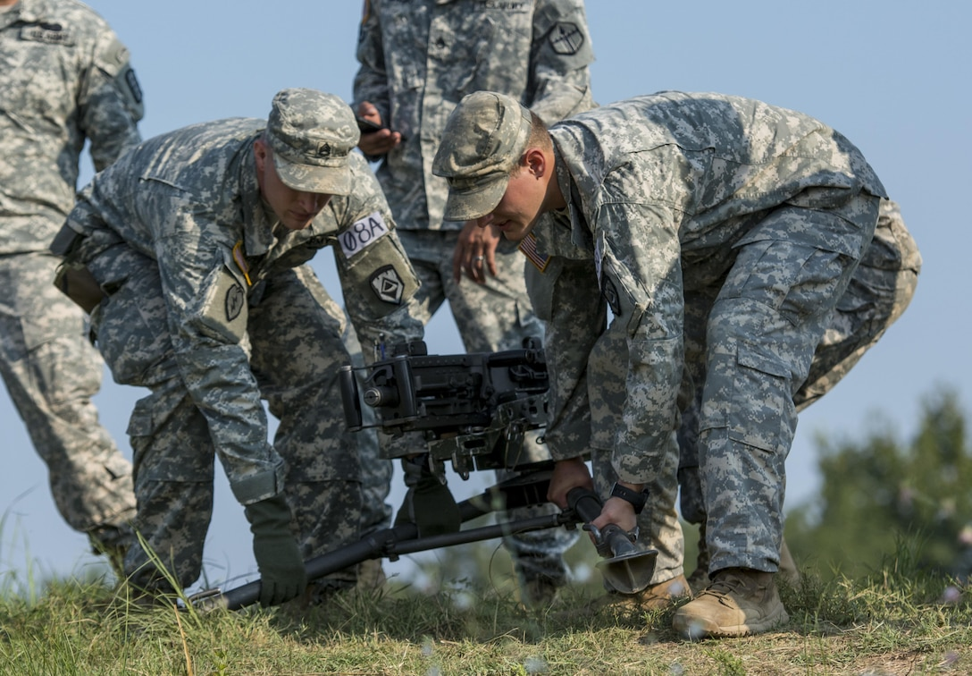 National Guard combat engineers with the 119th Engineer Company (Sapper), from West Virginia, pick up a .50-caliber M2 machine gun during a relay event during Sapper Stakes 2015 competition at Fort Chaffe, Ark., Sept. 1. The competition is designed to build teamwork, enhance combat engineering skills and promote leadership among the units. (U.S. Army photo by Master Sgt. Michel Sauret)