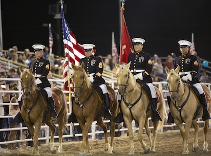 The Marine Corps Mounted Color Guard, from Marine Corps Logistics Base Barstow, Calif, enters the arena for the opening ceremony of the 2015 Barstow Rodeo Stampede, held aboard the base Sept. 25.
