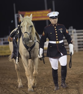 Cpl. Miguel Felix leads the riderless horse into the area during opening cermonies of the 2015 Barstow Rodeo Stampede, held aboard Marine Corps Logistics Base Barstow on Sept. 25.