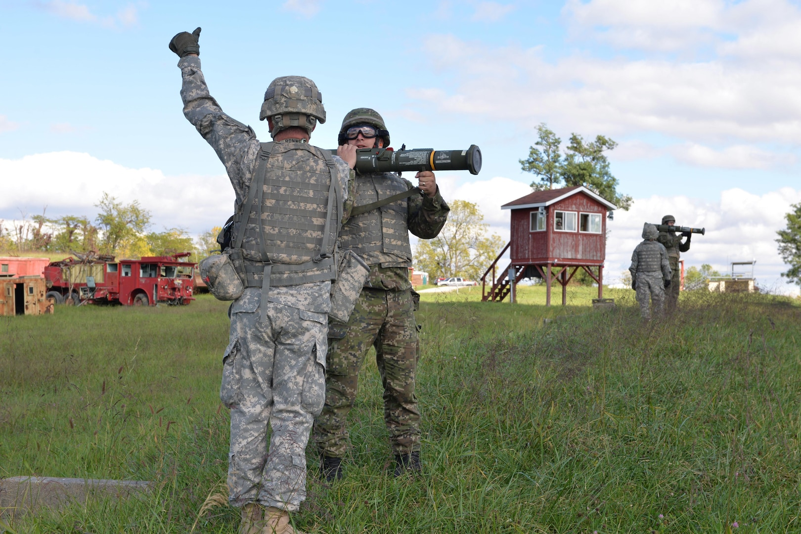 Soldiers from the Indiana National Guard and the Slovak Armed Forces prepare for firing an AT-4 weapon at Camp Atterbury, during the Indiana-Slovakia Exchange, Sept. 18, 2015.