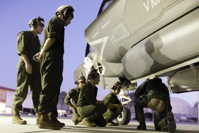 Marines inspect an F-35B Lightning II aircraft during a weapons and tactics instructor course on Marine Corps Air Station Yuma, Ariz., Oct. 1, 2015.  The Marines are with Marine Fighter Attack Squadron 121. U.S. Marine Corps photo by Chief Warrant Officer 3 Jorge A. Dimmer