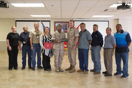 Brig.Gen. Edward D. Banta, commanding general Marine Corps Installation West-MCB Camp Pendleton, presents the 2014 Marine Corps Warrior Preservation Award to Col Sekou Karega, commanding officer of MCLB Barstow, and the base safety staff, Sept 29. The safety staff at MCLB Barstow is being recognized for their significant contributions and accomplishments in the area of safety, mishap prevention, and force preservation during fiscal year 2014.