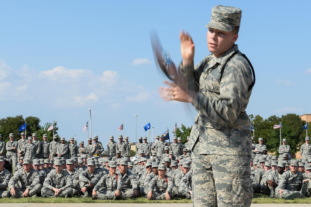 A technical training student at Sheppard Air Force Base, Texas, competes in a drill competition at the base parade grounds, Sept. 25, 2015. The drill competition promotes friendly rivalry and morale among the Airmen. (U.S. Air Force photo/Senior Airman Kyle Gese)