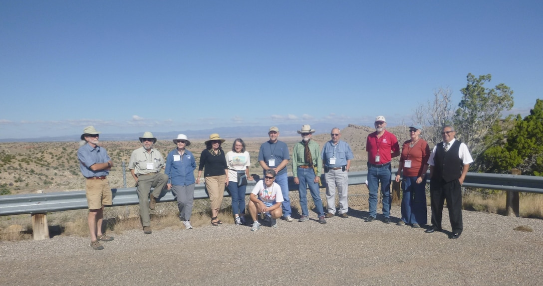 GALISTEO DAM, N.M. – District archaeologist Gregory Everhart (third from right) and conference attendees, pause during Everhart's tour of the dam, Sept. 20, 2015.