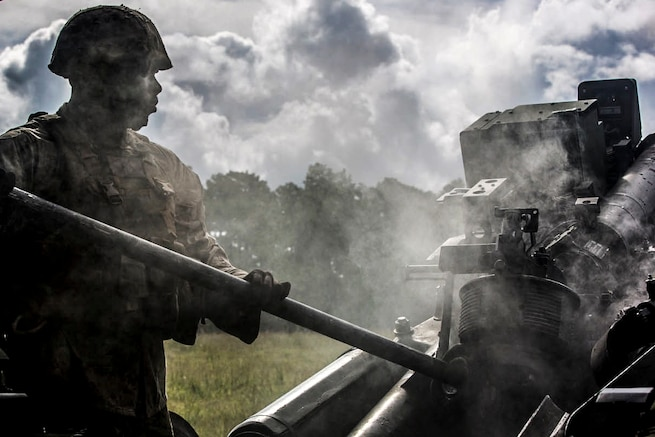Marine Corps Cpl. Anthony Payton swabs an M777 Howitzer after it was fired during a live-fire exercise on Camp Lejeune, N.C., Sept. 30, 2015. Payton is a field artillery cannoneer with Lima Battery, 2nd Battalion, 10th Marine Regiment, This was the last exercise the unit conducted as a standalone battery. U.S. Marine Corps photo by Cpl. Kirstin Merrimarahajara