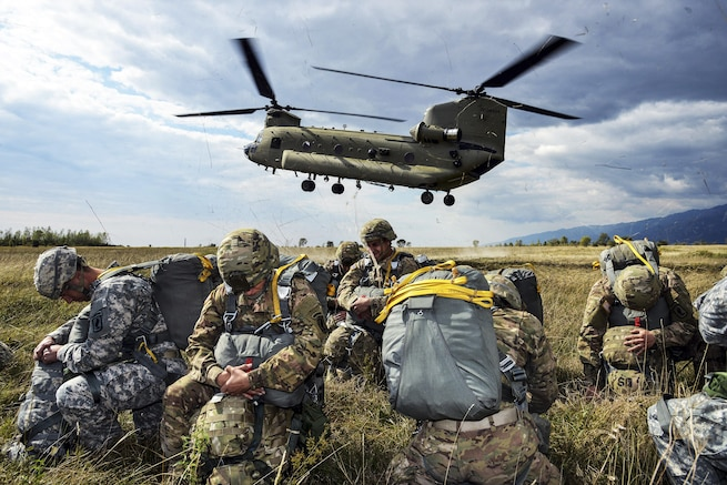 U.S. paratroopers prepare to board a U.S. Army CH-47 Chinook helicopter for an airborne operation at Juliet drop zone in Pordenone, Italy, Sept. 30, 2015. The paratroopers are assigned to the 173rd Brigade Support Battalion, 173rd Airborne Brigade. U.S. Army photo by Paolo Bovo