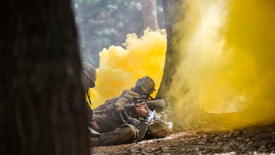 Republic of Korea Marine Lance Cpl. Jun Shin, left, provides buddy aid to a U.S. Marine during a gas attack drill as part of Korean Marine Exchange Program 15-12 at Gunha-Rhi, Republic of Korea, Sept. 17, 2015. The U.S. and ROK Marines practiced quickly putting on their gas mask and carrying the simulated wounded to safety. KMEP 15-12 is an exercise in a series of continuous bilateral training exercises that enhances the ROK and U.S. alliance, promotes stability on the Korean Peninsula and strengthens ROK and U.S. military capabilities and interoperability.
