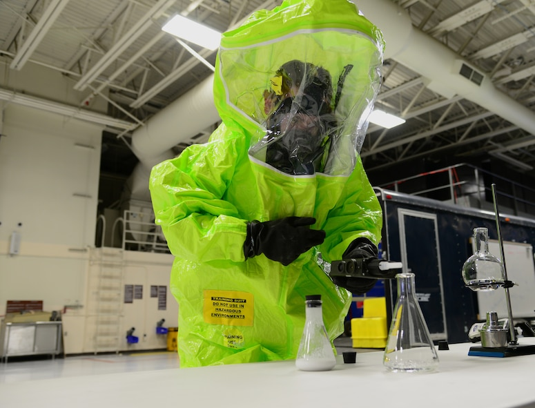 U.S. Air Force Senior Airman Sean Kirby, a 354th Civil Engineer Squadron emergency management journeyman, wears a hazardous materials training suit Sep. 29, 2015, at Eielson Air Force Base, Alaska. Kirby was demonstrating techniques to gain presumptive identification of an unknown chemical. (U.S. Air Force photo by Airman 1st Class Cassandra Whitman/Released)