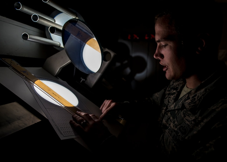 Staff Sgt. Erin O'Connell, a solar analyst with the 2nd Weather Squadron, Det. 4, creates a sunspot drawing from a projected image of the sun at the Holloman Solar Observatory on Sept. 24. Sunspots are temporary phenomena on the visible surface of the sun that appear visibly as dark spots compared to surrounding regions. The solar analysts closely monitor this information in order to safeguard and protect important assets in both civilian and Department of Defense agencies. (U.S. Air Force photo by Senior Airman Aaron Montoya)