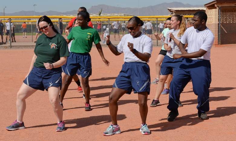 Airmen engage in an impromptu dance-off during festivities on Wingman Day 2015 at Luke Air Force Base, Sep. 30, 2015. Wingman Day 2015 included grilled food and live music. (U.S. Air Force photo by Airman 1st Class Ridge Shan)