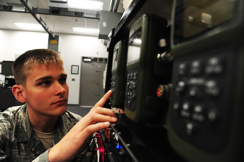 Airman 1st Class Michael Bentley, 509th Maintenance Squadron avionics backup technician, inspects an adaptable communication suite GPS receiver at Whiteman Air Force Base, Mo., Oct. 1, 2015. The GPS receiver, a new component, is used for the B-2 Spirit communication system. (U.S Air Force photos by Senior Airman Keenan Berry/Released)