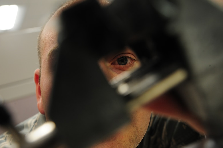 Staff Sgt. Andrew Walch, 509th Maintenance Squadron avionics backshop team leader, examines vice grip at Whiteman Air Force Base, Mo., Oct. 1, 2015. Vice grips are used to help stabilize B-2 Spirit stick grips during maintenance. (U.S Air Force photos by Senior Airman Keenan Berry/Released)