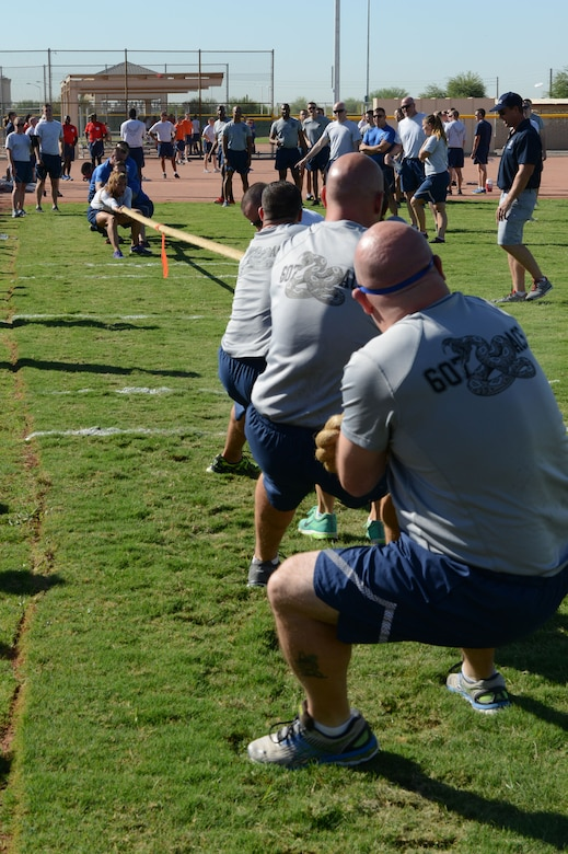 607th Air Control Squadron Airmen attempt to pull the rope from the 56th Security Forces Squadron Airmen during a tug of war match on Wingman Day at Luke Air Force Base, Arizona, Sept. 30, 2015. (U.S. Air Force photo by Senior Airman James Hensley)
