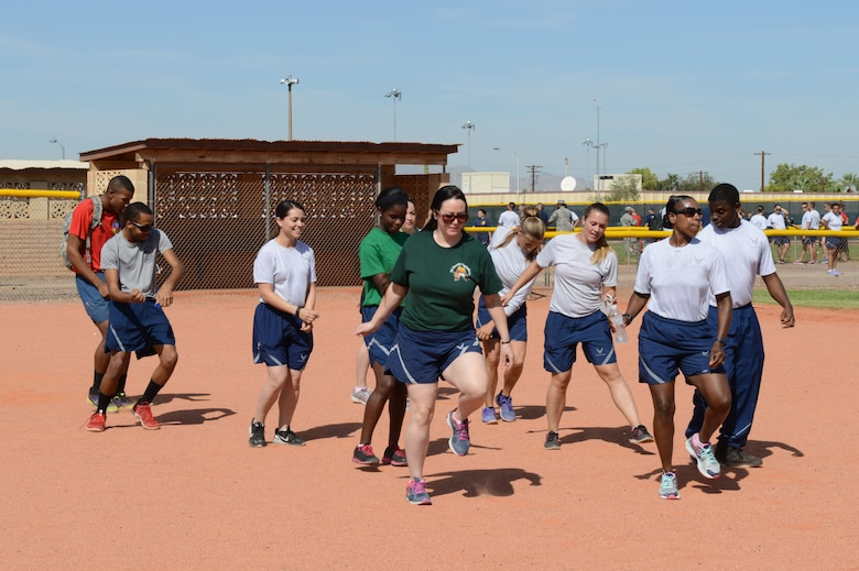 Luke Airmen dance to music during Wingman Day at Luke Air Force Base, Arizona, Sept. 30, 2015. Wingman Day featured several activities including basketball, ultimate Frisbee and more, and concluded with the wing promotion ceremony. (U.S. Air Force photo by Senior Airman James Hensley)