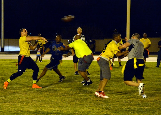 Benjamin Bright, 56th Dental Squadron, throws the football during an intramural flag football game against the 607th Aircraft Maintenance Squadron at Luke Air Force Base, Ariz., Sept. 24, 2015. 56th EMS/AGE defeats 607th ACS 21-14.  (U.S. Air Force photo by Senior Airman Devante Williams)