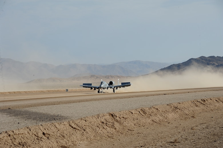 U.S. Air Force Maj. Paul Doran, 357th Fighter squadron pilot, lands an A-10C Thunderbolt II during austere landing training on Bicycle Lake Army Airfield at the National Training Center range, Fort Irwin, Calif., Sept. 22, 2015. Four 357th FS pilots participated in the training, which involved landing and taking off on an unimproved surface, during Green Flag-West 15-10.(U.S. Air Force photo by Senior Airman Betty R. Chevalier/Released)