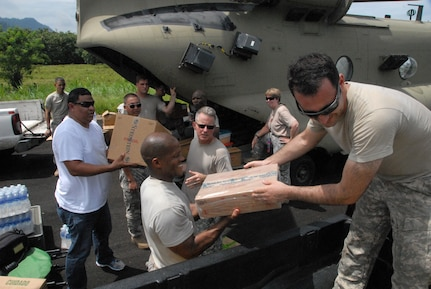 QUEBRADA NEGRA, Panama – Service members from Joint Task Force-Bravo and the Panamanian Ministry of Health load materials and supplies into a CH-47 Chinook, for the construction of latrines and water dispensing sites in Quebrada Negra, Panama, September 23, 2015, in order to provide sanitary conditions for the community. Medical readiness training exercises help foster good relationships and serve as a validation of teamwork between partner nations.   (U.S. Army photo by Sgt. Tia Sokimson)