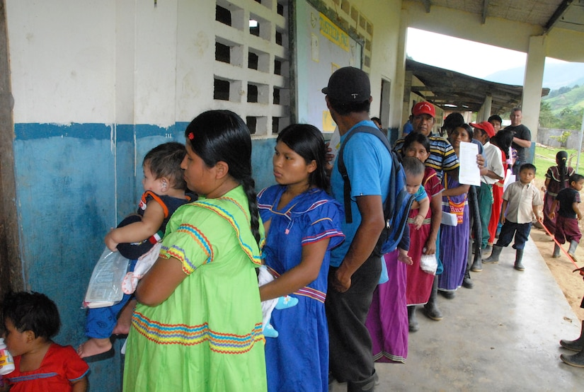 QUEBRADA NEGRA, Panama - Mothers wait in line to receive medical care with their children in Quebrada Negra, Panama, September 23, 2015, during a medical readiness training exercise that involved members from Joint Task Force-Bravo and the Panamanian Ministry of Health. Exercises such as these enhance readiness, foster partner nation response and capacity, and also validate JTF-Bravo's medical expeditionary capabilities. (U.S. Army photo by Sgt. Tia Sokimson)