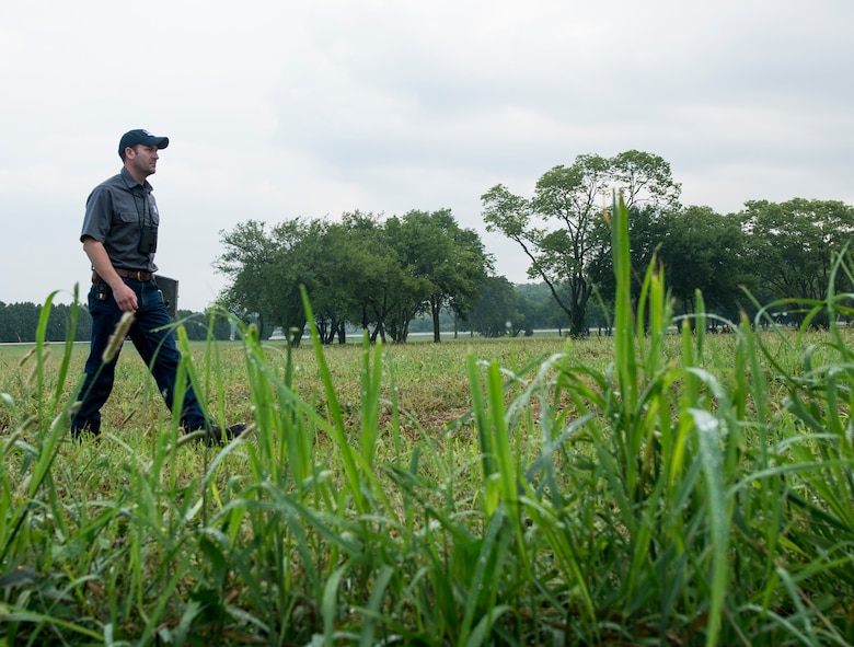 Government official walking through a field