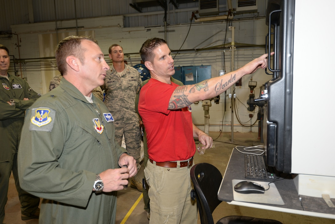 Master Sgt. James Gasaway, an air reserve technician assigned to the 513th Maintenance Squadron, shows off equipment in the fabricator section to Brig. Gen. David Hicks, the vice commander for 1st Air Force, on Sept. 29 during a brief visit to Tinker Air Force Base.  General Hicks toured the 552nd Air Control Wing and 513th Air Control Group to thank Airmen for their efforts in homeland defense and counter-drug operations.   (Air Force photo by Staff Sgt. Caleb Wanzer/Released)