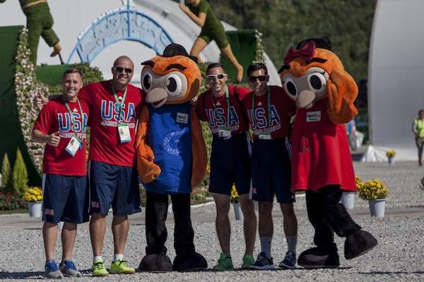 United States Men's Soccer Team Members pose for pictures with the Mascots for the 2015 6th CISM World Games during the Athlete Village Opening Ceremony. The CISM World Games provides the opportunity for the athletes of over 100 different Nations to come together and enjoy friendship through sport. The sixth annual CISM World Games are being held aboard Mungyeong, South Korea., Sept. 30 - Oct. 11.  (Photo by Sgt. Ashley N. Cano)