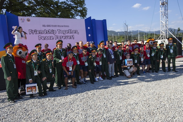 United States Men's Soccer Team pose for pictures with the Vietnamese Athletes during the 2015 6th CISM World Games, Athlete Village Opening Ceremony. The CISM World Games provides the opportunity for the athletes of over 100 different nations to come together and enjoy friendship through sport. The sixth annual CISM World Games are being held aboard Mungyeong, South Korea., Sept. 30 - Oct. 11.  (Photo by Sgt. Ashley N. Cano)